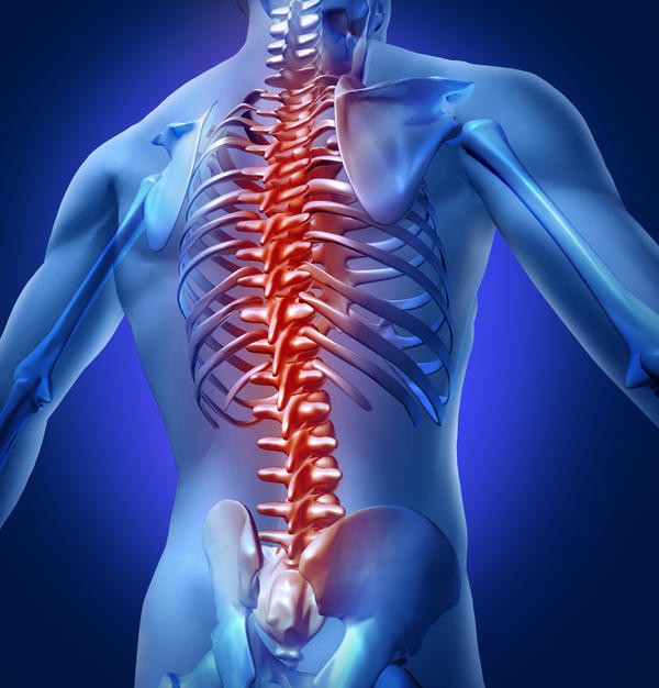 What causes lower back pain when you have inflammation around the T10 pain when sitting are laying down stiffness and numbness ?