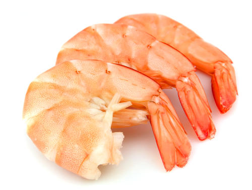 My stomach hurts when I have shrimp and salmon. Is this an allergy?