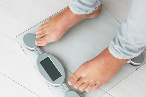 What can cause weight gain while taking lithium?
