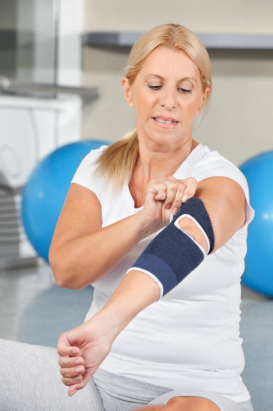 What are the symptoms of having tennis elbow?