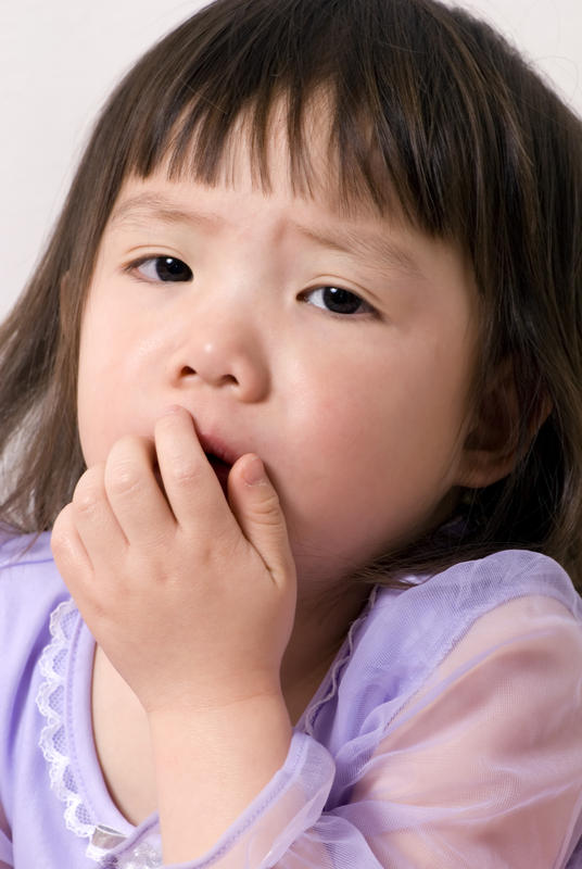 Can you cough up phlegm with black bits in whilst taking certain vitamin tablets?