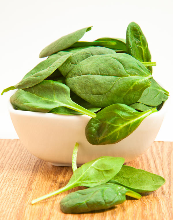 Is it ok to eat spinach and kale during pregnancy? All the packages say 110% vitamin a.  I read vitamin a causes birth defects.